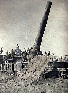 Railway gun artillery piece, mounted on and fired from a specially designed railway car