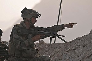 Groupement tactique interarmes de Kapisa - A member of marine troops (''marsouin'') pointing to guerrilla positions on 13 August 2009