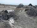 From this angle the mud volcanoes simply look like mounds of earth (37265399135).jpg