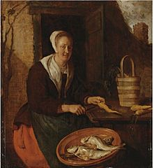 Woman Cleaning Carrots