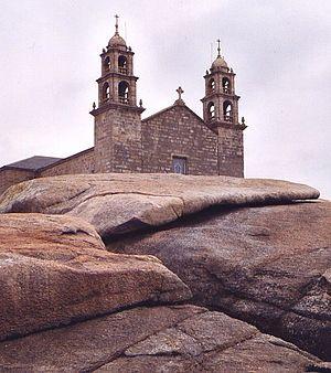 Muxía - Pedra d'Abalar (rocker stone) in front of Nosa Señora da Barca church in Muxía