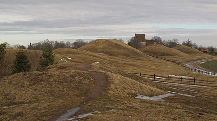 Burial mounds at Gamla Uppsala, the center of religious worship in Sweden until the destruction of its temple in the late 11th century. Gamla Uppsala.JPG
