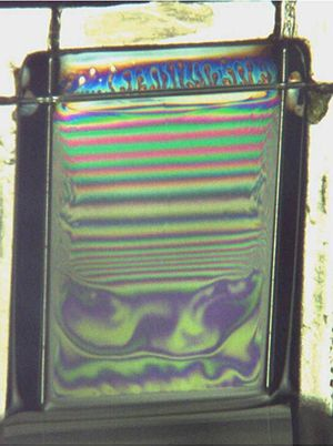 Soap film - Figure 4: Picture of a film taken during its generation. The film is pulled out of a soapy solution and drains from the top.