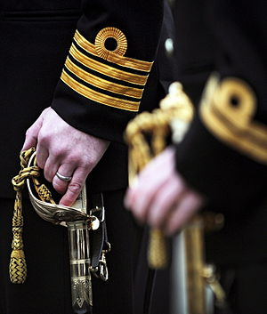 Captain (Royal Navy) - A Royal Navy captain's rank insignia during Divisions conducted at HMNB Clyde in January 2013.