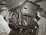 Harry Pike and unidentified woman looking at a Centrex projector, 1940 - 1949 (4773149205).jpg