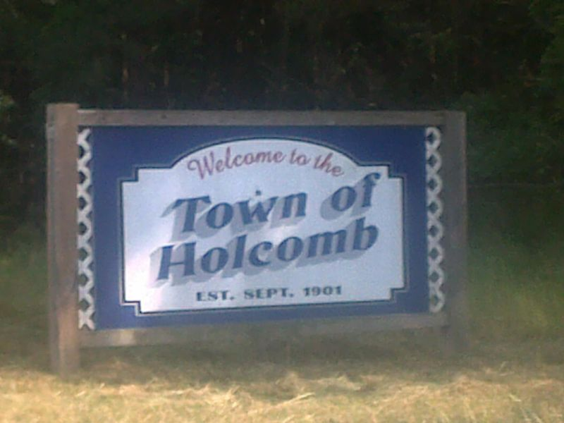 File:HolcombTownSign.jpg