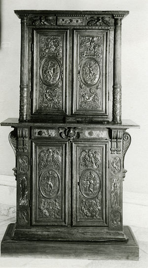 Cabinetry - Crafted by Hughes Sambin (1570-1600), double cabinet features the combination of architectural elements and relief carving that is characteristic of French furniture of the period.