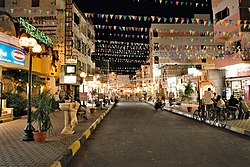Hurghada, main street of the bazaar in El Dahar at night, during Ramadan, Egypt, Oct 2004.jpg