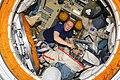ISS-37 Oleg Kotov works with a Russian Orlan spacesuit in the Pirs module.jpg