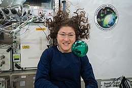 ISS-60 Christina Koch with a green bubble in the Kibo lab.jpg