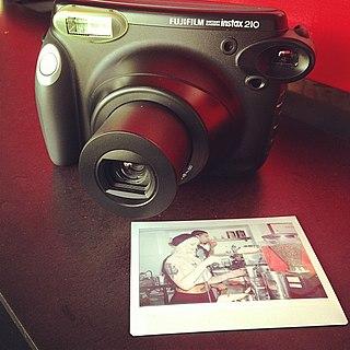 Instax brand of instant still cameras