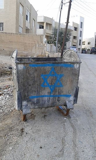 Flag desecration - Israeli flag graffitied on a trash bin, Amman.