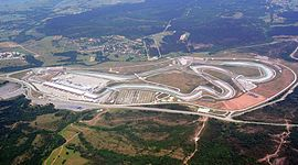Istanbul Park is in a rural area and is paved with tarmac. It has large concrete and gravel run-off areas, large grandstands and a substantial pit building and paddock.