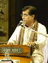 A person singing with Harmonium