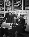 John Grierson (left), Chairman of the Wartime Information Board, meeting with Ralph Foster, Head of Graphics, National Film Board of Canada, to examine a series of posters produced by the National Film Board of Canada.jpg