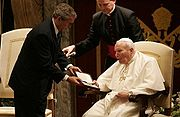 President Bush presents the Presidential Medal of Freedom to Pope John Paul II during a visit to the Vatican, June 2004