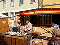 Kürtőskalács makers. Street fair. - Fortuna Street. Buda Castle Quarter, Budapest.JPG