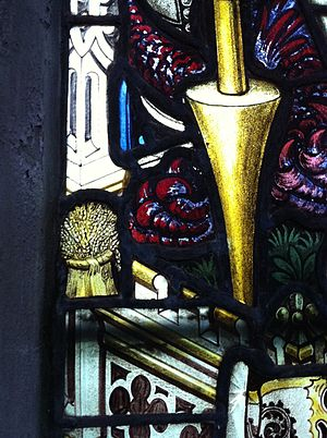 Charles Eamer Kempe - The Kempe company maker's mark, the Wheatsheaf, on a window in St Mary's Church, Nottingham