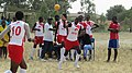 Kwanthanze players casually pass the ball around during a hand ball game.jpg