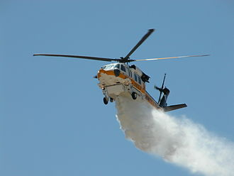 Los Angeles County Fire Department - Copter 16, a S-70A Firehawk performs a water drop demonstration.