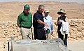 Laura Bush, Ehud Olmert, and Aliza Olmert listen as President George W. Bush talks about the water system at Masada.jpg