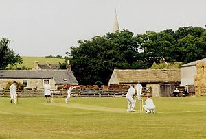 Ledsham, West Yorkshire - A game of Cricket in Ledsham, 2003 (note church spire in the background)