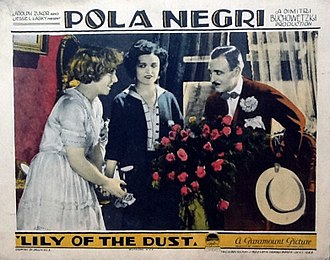 Raymond Griffith - Lobby card for Lily of the Dust (1924) with Jeanette Daudet, Pola Negri, and Raymond Griffith