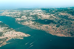 Aerial view of the city of Lisbon and its suburbs, with the Tagus river separating it from the city of Almada
