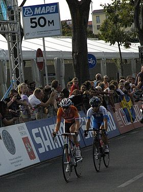 Lucinda Brand and an Italian rider in the women's road race.JPG