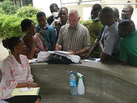 MSF logistician in Nigeria showing plans MSF logistician showing plans.jpg