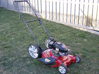 "Lawn mower - A typical modern gasoline/petrol powered rotary ""push mower"" (or grass cutter) which has self-powered cutting blades, but still requires human power to move across the ground. ""Walk-behind"" mowers can be self-propelled, only requiring a human to walk behind and guide the mower. Mowers of the type displayed usually vary in width from 20 to 24 inches."