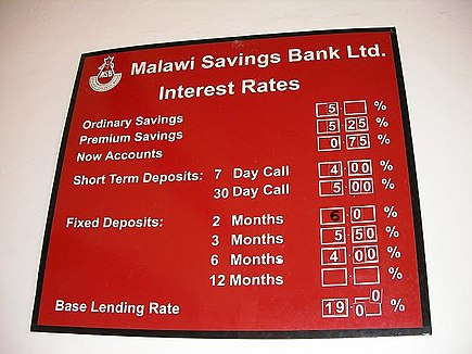 A bank sign in Malawi listing the interest rates for lending money to its customers Malawi interest rates.JPG
