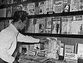 Man looking at magazines, Tambahan dan Pembetulan Pekan Buku Indonesia 1954, p92.jpg