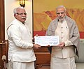 Manohar Lal Khattar presents a demand draft worth Rs. 5 crore to the Prime Minister, Shri Narendra Modi, towards the Prime Minister's National Relief Fund (PMNRF), in New Delhi on December 09, 2015.jpg