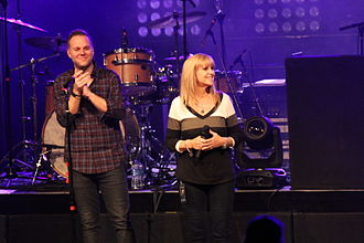 "Matthew West - West on stage with Renee Napier. Her story inspired his song ""Forgiveness"""