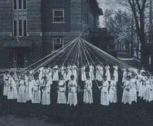 History of Ohio University - Women at Ohio University in the early 1900s performing a Maypole dance as a rite of Spring, by a queen and attendants, on the College Green.