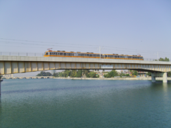 Metro train crossing Seyhan River.png