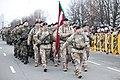 Ministru prezidents Valdis Dombrovskis vēro Nacionālo bruņoto spēku vienību militāro parādi 11.novembra krastmalā (8195456445).jpg
