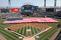 More than 100 U.S. Sailors from Navy Region Midwest, Navy Recruiting Chicago and Naval Station Great Lakes hold an American Flag during the National Anthem at opening day ceremonies for the Chicago White Sox 080407-N-IK959-187.jpg