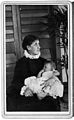Mrs. T.R. Lewis seated with baby. Wellcome M0016181.jpg