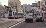 N Judah train crossing 10th Avenue, March 2001.jpg