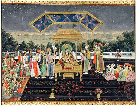 The Persian king Nader Shah seated upon the Peacock Throne with members of the court, after his victory at the Battle of Karnal Nadir Shah on the Peacock Throne after his defeat of Muhammad Shah. ca. 1850, San Diego MOA.jpg