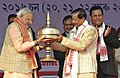 Narendra Modi being presented a meemnto at the 85th Annual Conference of Srimanta Sankaradeva Sangha, at Sibasagar, Assam. The Minister of State for Youth Affairs and Sports (Independent Charge).jpg