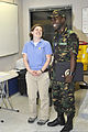 Naval Criminal Investigative Service Special Agent Allyson Kidd, left, shares a laugh with Tanzanian army 2nd Lt. Hamad Kipango after a port security fundamentals course aboard high speed vessel Swift (HSV-2) 120627-N-UG232-039.jpg