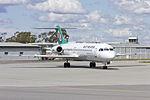 Network Aviation (VH-NHM) Fokker 100 taxiing at Wagga Wagga Airport (1).jpg