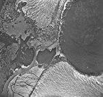 Norris and Taku Glaciers, terminus of valley glacier, kame, and braided rivers, August 27, 1968 (GLACIERS 6061).jpg