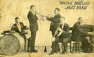 "Jazz standard - The Original Dixieland Jazz Band, from the original 1918 promotional postcard while the band was playing at Reisenweber's Cafe in New York City. Shown are (left to right) Tony Sbarbaro (aka Tony Spargo) on drums; Edwin ""Daddy"" Edwards on trombone; D. James ""Nick"" LaRocca on cornet; Larry Shields on clarinet, and Henry Ragas on piano."