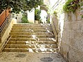 Old Jerusalem courtyard and stairs.JPG