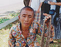 Old woman who chain sells Indonesia.jpg