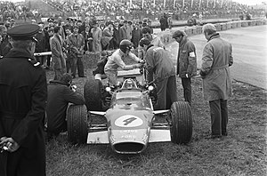 Jackie Oliver - Oliver instructing officials to sort the Lotus 49 at the 1968 Dutch Grand Prix.
